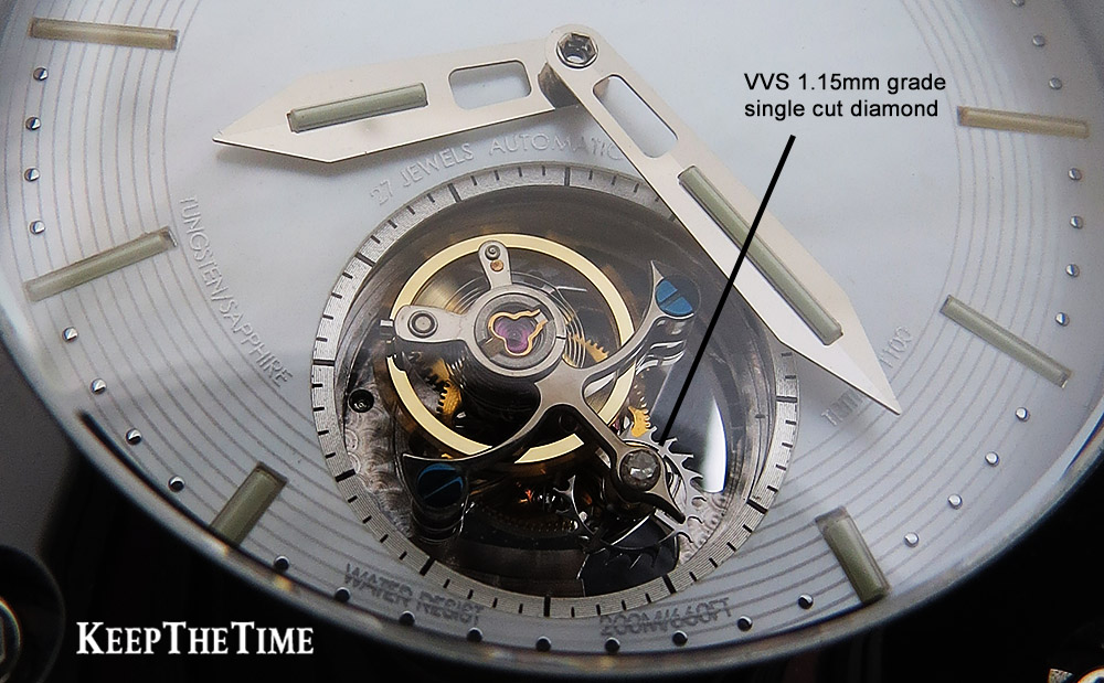 View into the flying toubillon movement at 6:00 including a VVS 1.15mm grade single cut diamond on the tourbillon cage